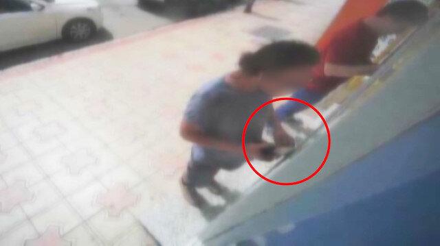 ATM'de unutulan parayı çalan hırsız kamerada