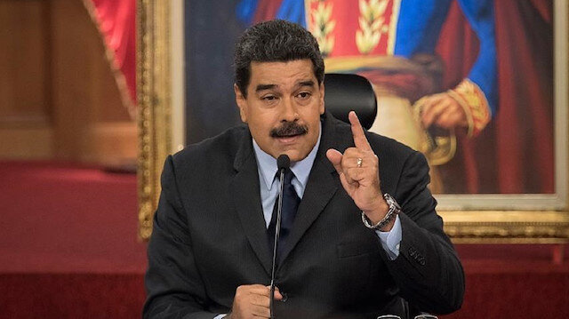 Venezuela's President Nicolas Maduro gestures as he speaks during a news conference