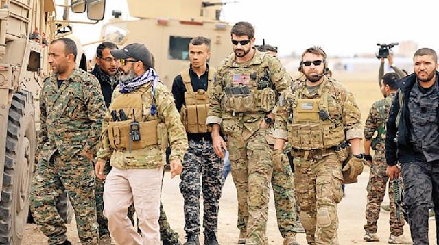 ABD askerleri PKK'lılarla kol kola görüntülenmişti.
