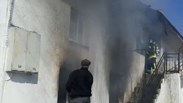 Gözyaşları içerisinde evinin yanışını izledi