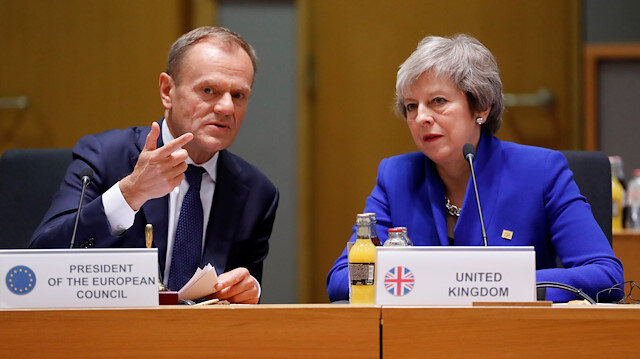 File photo: FILE PHOTO: British Prime Minister Theresa May (R) and European Union Council President Donald Tusk during the extraordinary EU leaders summit to finalise and formalise the Brexit agreement in Brussels