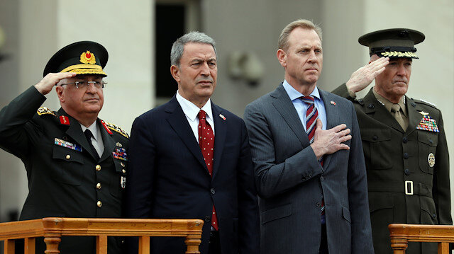 File photo: U.S. Acting Defense Secretary Patrick Shanahan (2nd R) and Joint Chiefs Chairman Marine Gen. Joseph Dunford (R) review troops as they welcome Turkish Minister of Defense Hulusi Akar (2nd L) to the Pentagon in Arlington, Virginia, U.S., February 22, 2019.