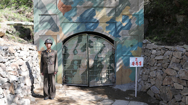 File photo: A North Korean soldier stands guard in front of the second tunnel of Punggye-ri nuclear test ground before it is blown up during the dismantlement process in Punggye-ri, North Hamgyong Province, North Korea May 24, 2018.