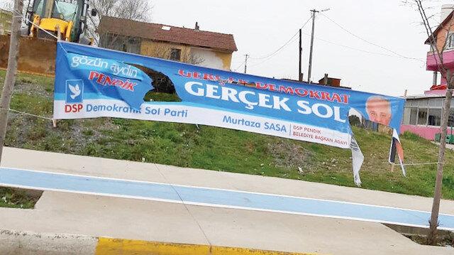 DSP Pendik Belediye Başkan Adayı Murtaza Sasa'nın kesilen pankartı.