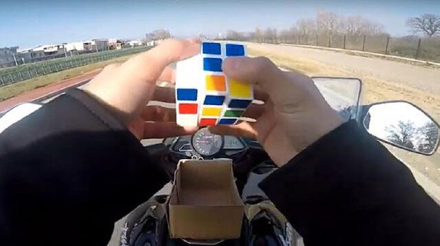 Fame-seeking Turkish motorcyclist arrested for solving Rubik's cube while driving