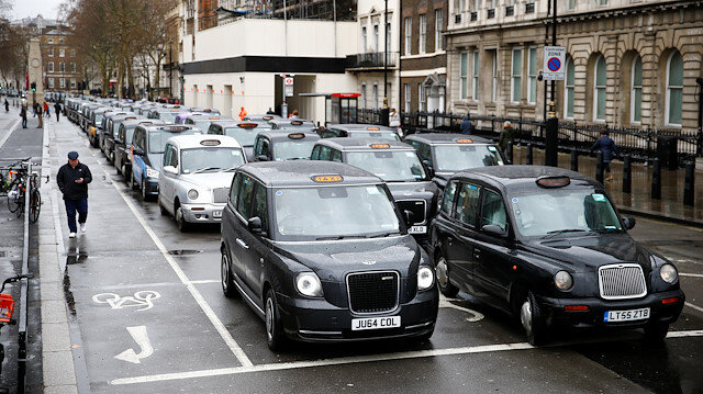 File photo: London taxi drivers stage a road block protest