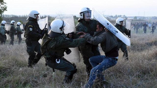 Kuzey Makedonya'ya geçmeye çalışan göçmenler polisle çatıştı