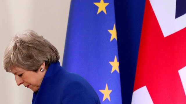 British Prime Minister Theresa May leaves after a news conference following an extraordinary European Union leaders summit to discuss Brexit, in Brussels, Belgium April 11, 2019.