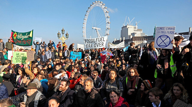 Thousands of climate change activists have blocked main roads in London on Monday.