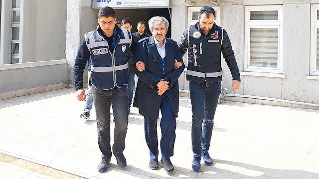 ÖSYM eski Başkanı Ali Demir'in adliiyeye sevk edilirken çekilen fotoğrafı.