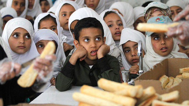 File photo: Yemeni students wait to get free food from a local charity at a school in Sanaa