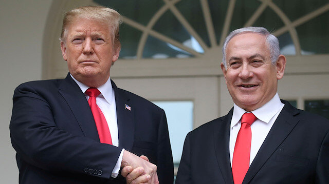 File photo: U.S. President Donald Trump shakes hands with Israel's Prime Minister