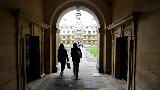 File photo: People walk into the quadrant of Clare College at Cambridge University in eastern England