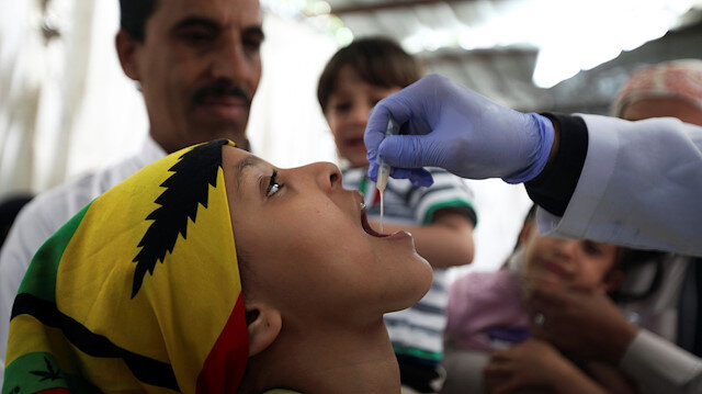 File photo: A girl receives a cholera vaccination during a house-to-house immunization campaign in Sanaa, Yemen