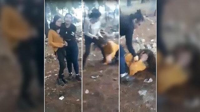 Genç kızların ormanda başka bir kıza şiddet uyguladıkları anlar kamerayla kaydedildi.