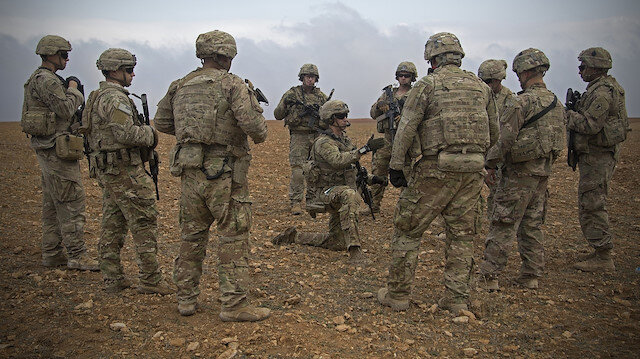 ABD Irak'tan 'acil durumda çalışmayan' personelini çekiyor.