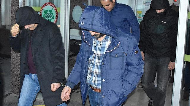 Gözaltına alınan isimler adliyeye götürülürken. Fotoğraf: Arşiv.