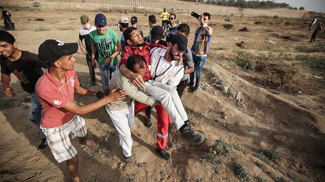 İsrail işgal güçleri Gazze sınırında 11 Filistinliyi yaraladı