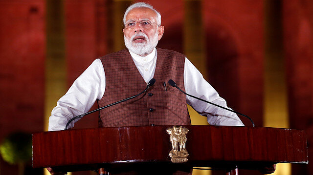FILE PHOTO: India's Prime Minister Narendra Modi speaks to the media after his meeting with President Ram Nath Kovind, to stake claim to form the new government at the Presidential Palace in New Delhi, India May 25, 2019. REUTERS/Altaf Hussain/File Photo