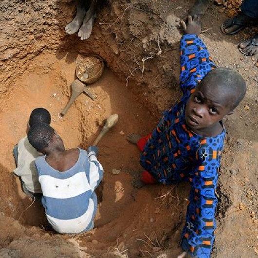Children descend into hard earth to dig for gold in Kenya