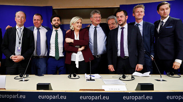 Finnish MEP Jussi Halla-Aho, Austrian MEP Harald Vilimsky, Italian MEP Marco Zanni, French far-right National Rally (Rassemblement National) party leader Marine Le Pen, German MEP Jorg Meuthen, Belgian MEP Gerolf Annemans, French MEP Nicolas Bay, Danish MEP Peter Kofod and Estonian MEP Jaak Madison pose after a joint news conference on the formation of a new far-right European Parliament group to represent nationalists' interests at the EU Parliament in Brussels, Belgium