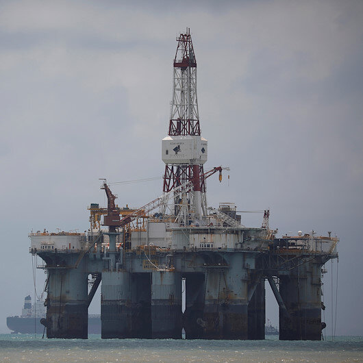 Oil prices down as output, stocks remain high in US