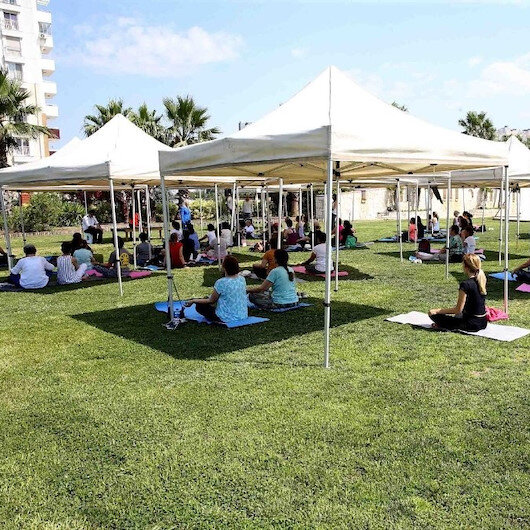 Turkish citizens detox body and mind with yoga