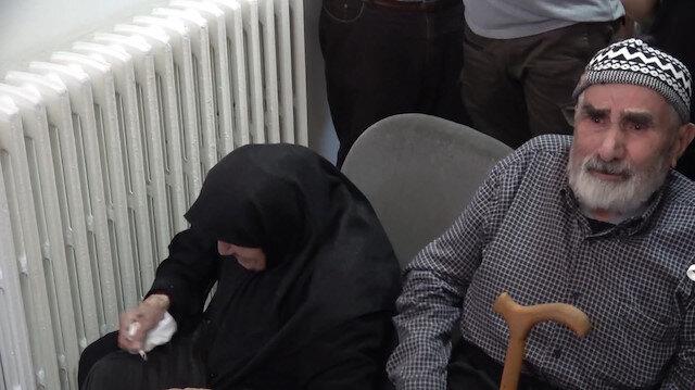 Şehidimizin ailesi evlatlarının resmini Türk bayrağında görünce gözyaşlarına hakim olamadı