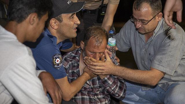 Salih'in babası ve yakınları çocuklarının cansız bedeni görünce gözyaşlarına boğuldu.