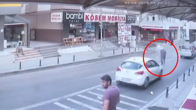 Kadının 4üncü kattan otomobilin üzerine düşme anı kamerada