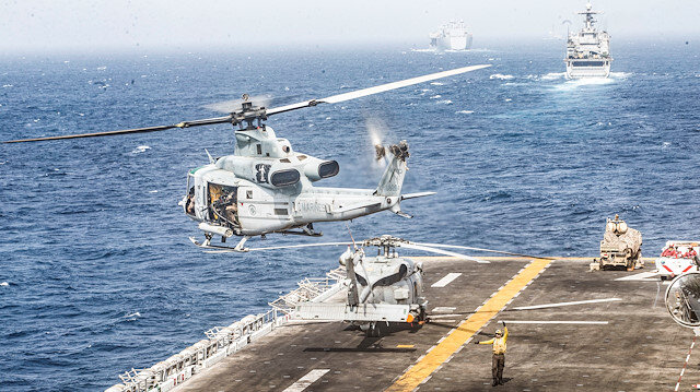A UH-1Y Venom helicopter with Marine Medium Tiltrotor Squadron (VMM) 163 (Reinforced), 11th Marine Expeditionary Unit (MEU), takes off from the flight deck of the amphibious assault ship USS Boxer (LHD 4) during its transit through Strait of Hormuz in Gulf of Oman, Arabian Sea, July 18, 2019.