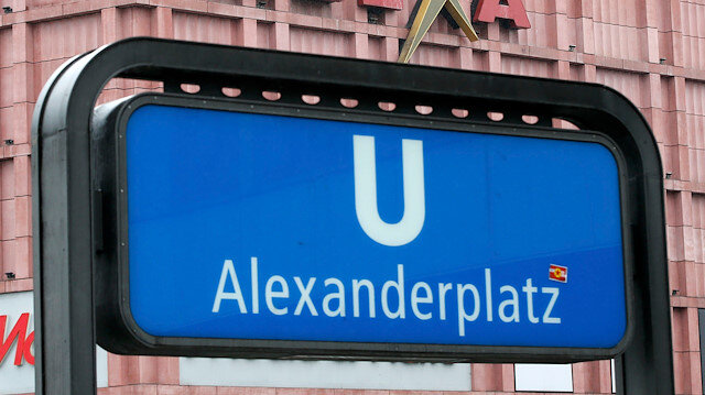An entrance to the subway is pictured next to a sign of Alexia shopping mall at Alexanderplatz