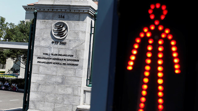 A logo is pictured outside the World Trade Organization (WTO) headquarters next to a red traffic light in Geneva, Switzerland, October 2, 2018. REUTERS/Denis Balibouse/File Photo