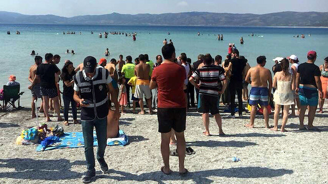 Kayadibi plajında suya giren Hasan İlhan'ın yarım saat sonra cansız bedenine ulaşıldı.