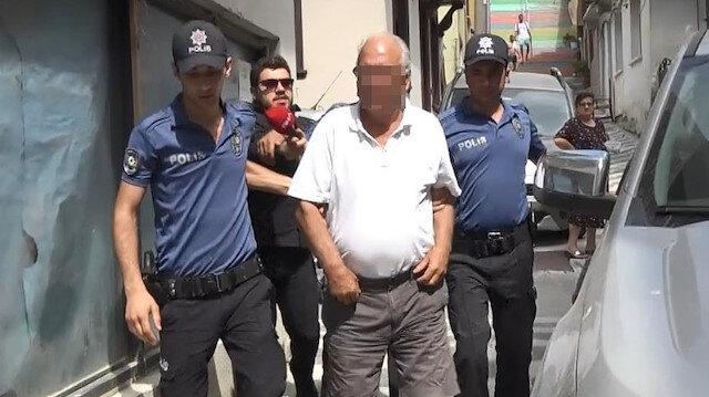 Marmara Adası'nda gözaltına alınan baba- oğul adliyeye getirilirken.