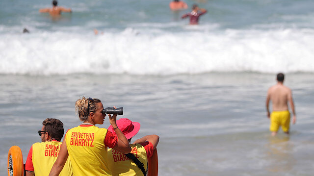 Lifeguards watch swimmers at the beach ahead of the G7 summit in Biarritz, France, August 23, 2019.