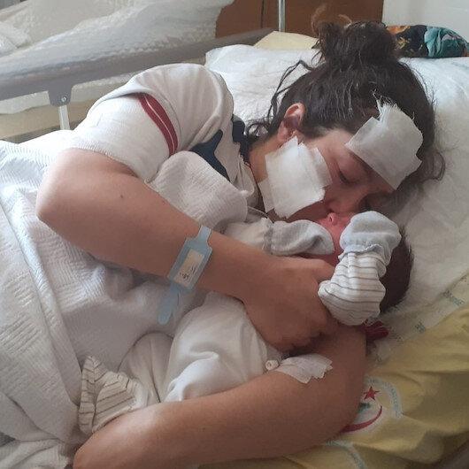 Doğum yaptıktan sonra eşi tarafından bıçaklanan kadın bebeğini kucağına aldı