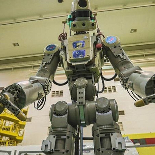 Russian rocket with humanoid robot docks Space Station
