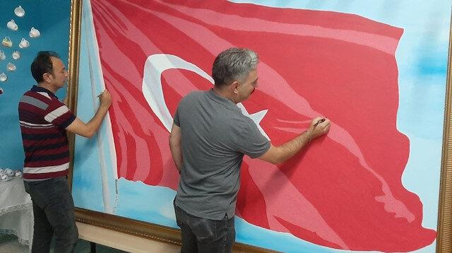 Şanlı Türk bayrağına 36 bin 647 şehidin ismini yazdılar