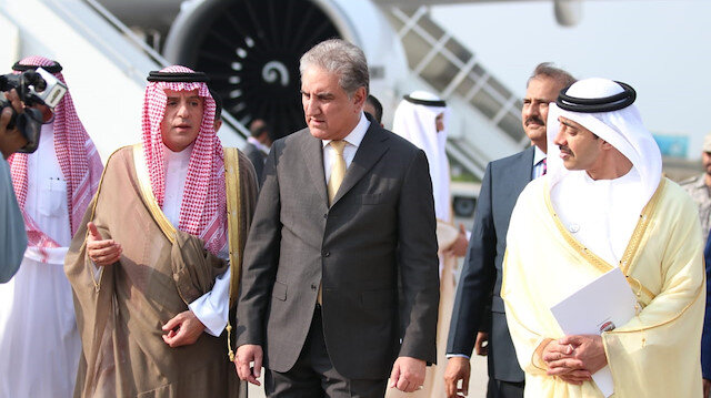 Pakistan's Foreign Minister, Shah Mehmood Qureshi (R) welcomes UAE Minister of Foreign Affairs and International Cooperation Sheikh Abdullah bin Zayed Al Nahyan (L) upon his arrival at Noor Khan Airbase in Islamabad on September 04, 2019.