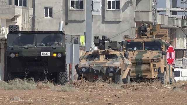 Military vehicles are seen in the Akçakale district