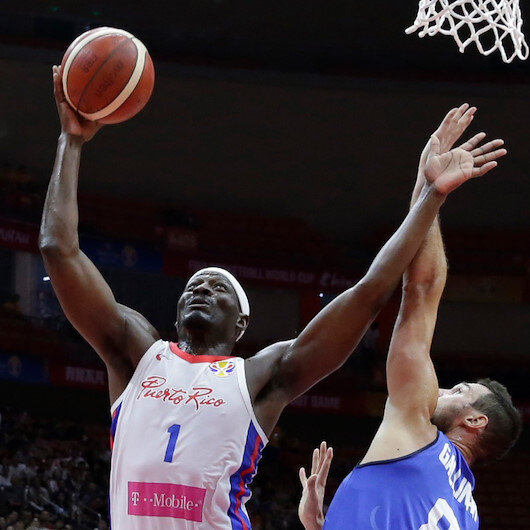 Italy beats Puerto Rico, unable to play in World Cup QF