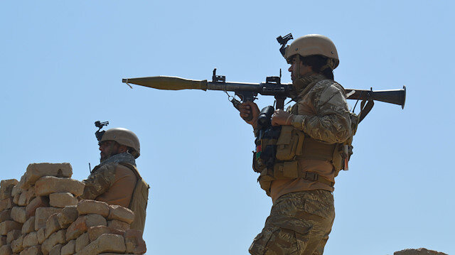 File photo: Afghan security forces take position during a battle with the Taliban