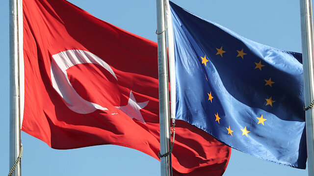 European Union (R) and Turkish flags