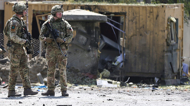 Foreign troops with NATO-led Resolute Support Mission investigate at the site of a suicide attack in Kabul, Afghanistan September 5, 2019. REUTERS/Omar Sobhani