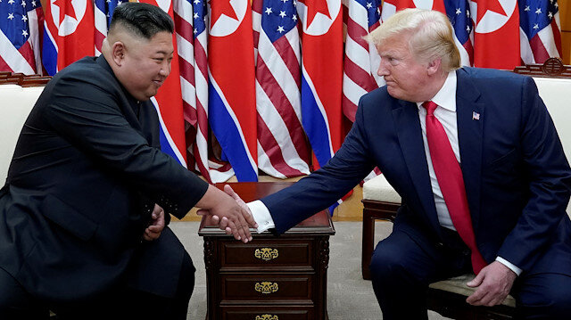 U.S. President Donald Trump shakes hands with North Korean leader