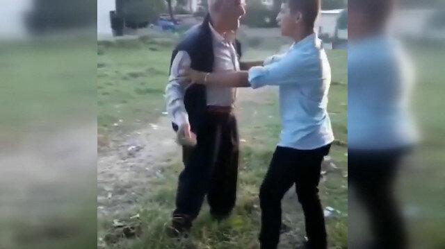 Yavru köpeği ve çocuğu taşladı