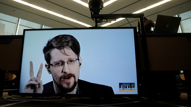 Edward Snowden speaks via video link as he takes part in a round table on the protection of whistleblowers at the Council of Europe in Strasbourg, France, March 15, 2019.