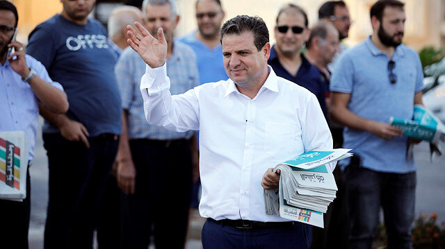 Ayman Odeh, leader of the Joint List, gestures as he hands out pamphlets during an an election campaign event in Tira, northern Israel September 5, 2019. Picture taken September 5, 2019. REUTERS/Amir Cohen