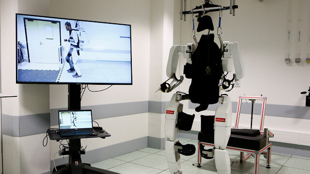Paralysed man hails 'feat' of walking again with robot exoskeleton